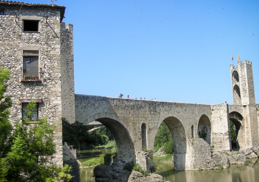 A view of the medieval bridge leading into Besalu, Spain.