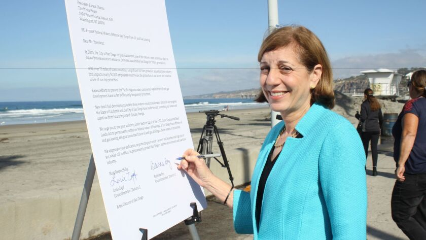Barbara Bry signs the letter sent to President Obama on Monday, Jan. 9 to ban offshore drilling in San Diego.