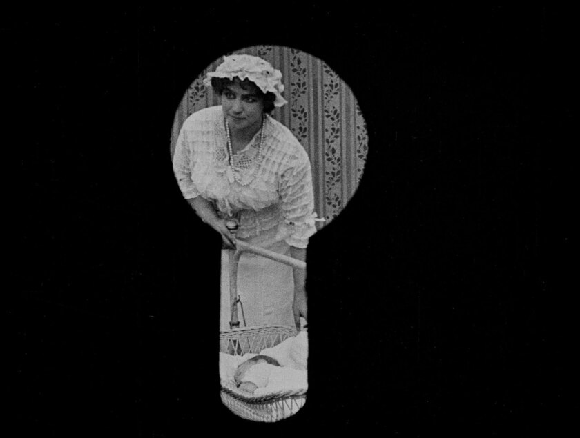 Film still from the movie SUSPENSE (1913) -- directed by Lois Weber.