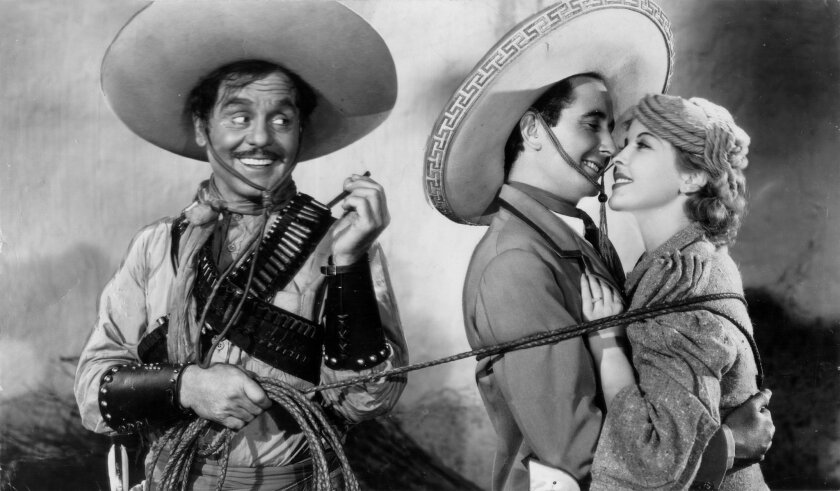 """Leo Carrillo (left) co-starred with Ida Lupino (right) and Italian opera singer Nino Martini in the Western parody """"The Gay Desperado,"""" which was produced by Mary Pickford. (1936 file photo)"""