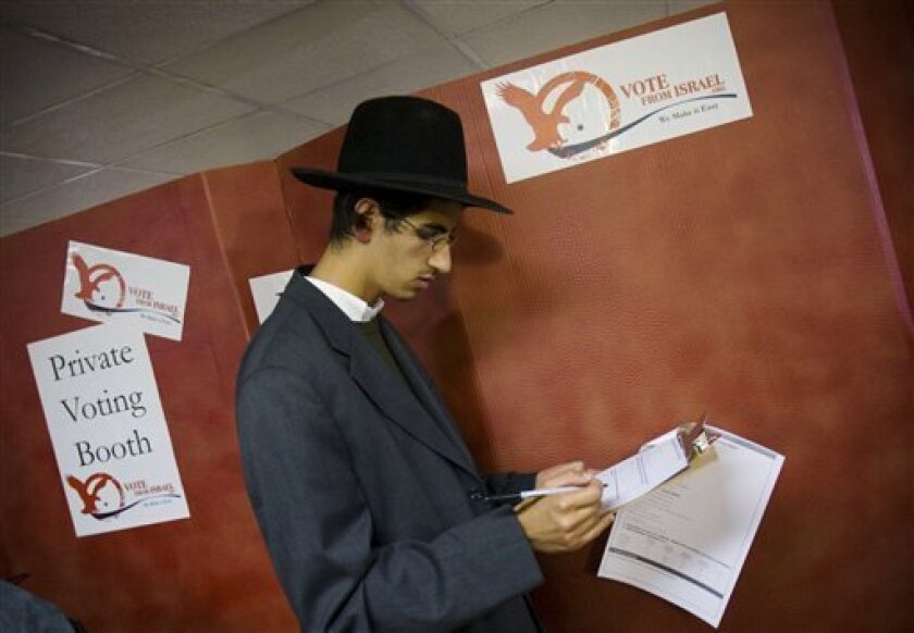 An American voter is seen at a ballot station in Jerusalem, Tuesday, Oct. 28, 2008. The two hundred and fifty thousand Americans living in Israel appear to overwhelmingly support Republican presidential candidate Sen. John McCain. About forty thousand are expected to vote. (AP Photo/Bernat Armangue