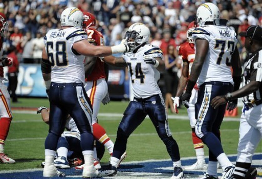 San Diego Chargers running back Ryan Mathews, center, celebrates with teammates  Kris Dielman, left, and  Marcus McNeill after scoring a touchdown against the Kansas City Chiefs in the first half of an NFL football game  Sunday, Sept. 25, 2011, in San Diego. (AP Photo/Denis Poroy)
