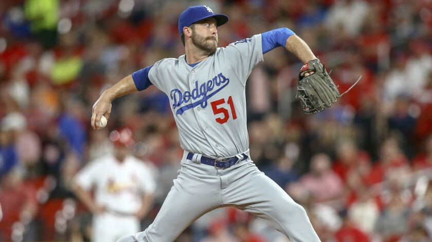 Los Angeles Dodgers relief pitcher Dylan Floro (51) pitches during the fourth inning of a baseball g