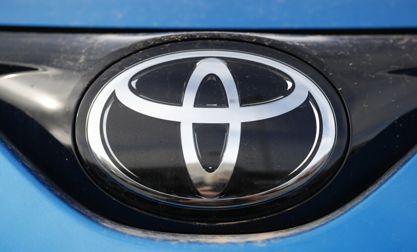 "Toyota is staking out its position in a battle to make cars safer by getting them to ""talk"" with one another, laying out plants to start putting short-range communications chips in U.S. vehicles in the next three years."