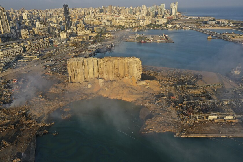 Smoke rises from the scene of an explosion that hit the seaport of Beirut, Lebanon, Wednesday, Aug. 5, 2020. (AP Photo/Hussein Malla)