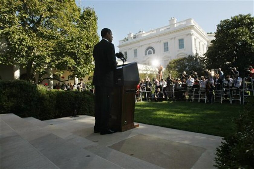 FILE - In this Oct. 9, 2009, file photo, President Barack Obama makes remarks about him being awarded the Nobel Peace Prize in the Rose Garden of the White House in Washington. He's the Nobel Peace Prize winner who just ordered 30,000 more troops to war. He's the laureate who says he doesn't deserve the award. He's not quite 11 months on the job and already in the company of Mother Teresa and the Dalai Lama. (AP Photo/Gerald Herbert, File)