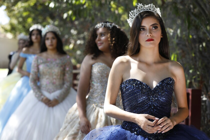 Valeria Amor, 19, leads a group of models as they take the stage for a fashion show featuring gowns from Lili's Creations in Chula Vista. The show was one of a number of cultural attractions showcased at the Hispanic Heritage Festival.