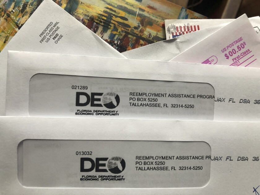 Envelopes from the Florida Department of Economic Opportunity Reemployment Assistance Program
