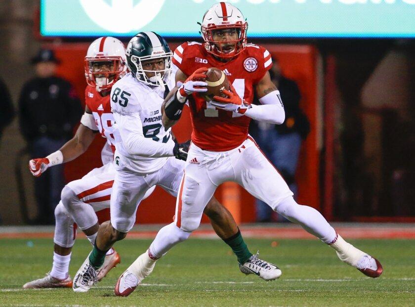 Nebraska cornerback Jonathan Rose (14) intercepts a throw intended for Michigan State wide receiver Macgarrett Kings Jr. (85) during the first half of an NCAA college football game in Lincoln, Neb., Saturday, Nov. 7, 2015. (AP Photo/Nati Harnik)