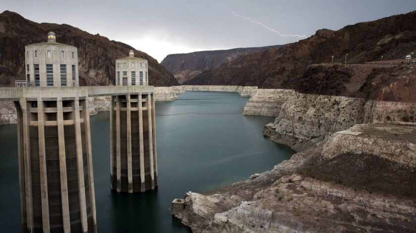 FILE - In this July 28, 2014, file photo, lightning strikes over Lake Mead near Hoover Dam that impo