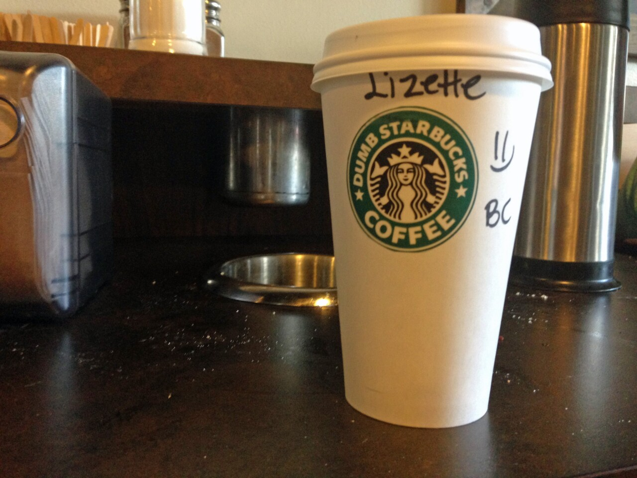 A Dumb Starbucks cup with its pasted-on sticker.