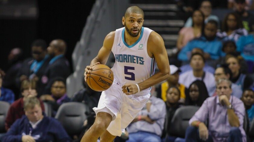 Charlotte's Nicolas Batum controls the ball during a game against the Chicago Bulls.