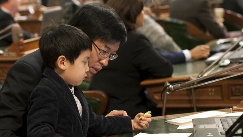 "California Sen. Richard Pan, shown with his son William in 2010, says: ""As a pediatrician, I have personally witnessed children suffering lifelong injury and death from vaccine-preventable infection."""