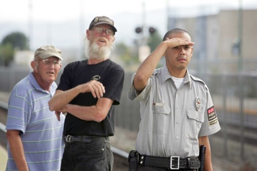 """Bob Atkinson, Chris Cassel and Chris Watson, from left, say the Metrolink train didn't run a red light. """"I saw the light was green. Everything seemed all right,"""" Watson said."""