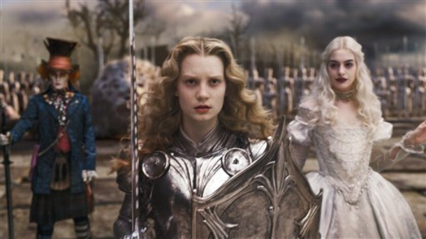 "In this film publicity image released by Disney, Johnny Depp, left, Mia Wasikowska, center, and Anne Hathaway are shown in a scene from the film ""Alice in Wonderland."" Audiences are mad as hatters about Johnny Depp and Tim Burton's ""Alice in Wonderland,"" helping it earn a whopping $41 million in its first day, Friday, March 5, 2010. (AP Photo/Disney)"