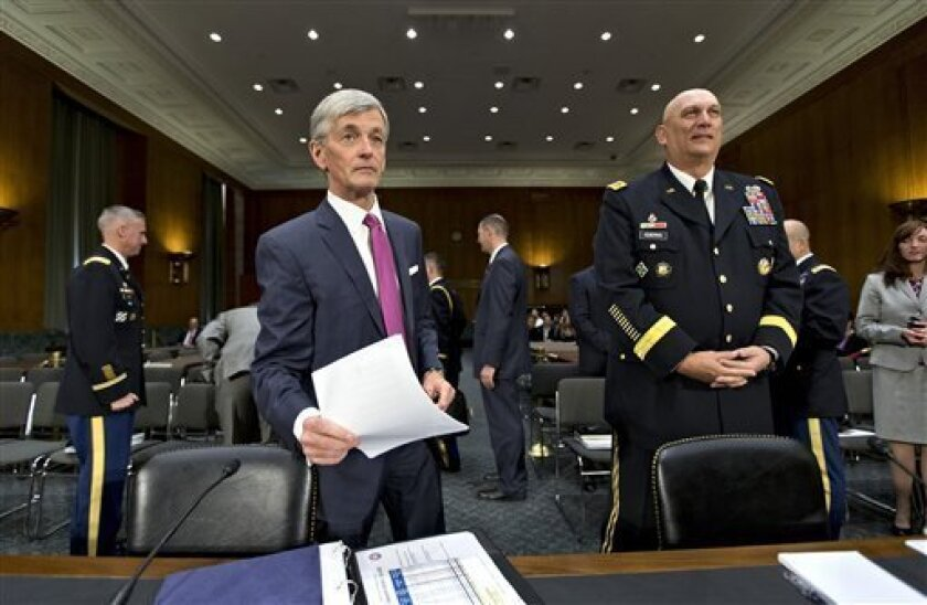 Army Secretary John McHugh, left, and Army Chief of Staff Gen. Ray Odierno, arrive on Capitol Hill in Washington, Tuesday, April 23, 2013, to testify before the Senate Armed Services Committee hearing on the Defense Department budget requests for fiscal year 2014.  (AP Photo/J. Scott Applewhite)
