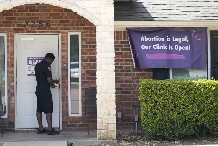 A security guard opens the door to the Whole Women's Health Clinic in Fort Worth, Texas, Wednesday, Sep. 1.