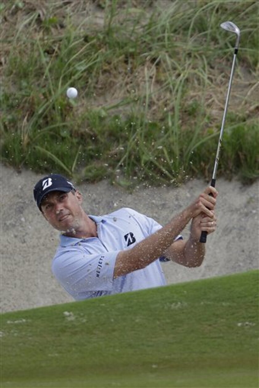 Matt Kuchar hits out of the sand near the 17th hole during the second round of the PGA Championship golf tournament on the Ocean Course of the Kiawah Island Golf Resort in Kiawah Island, S.C., Friday, Aug. 10, 2012. (AP Photo/Chuck Burton)