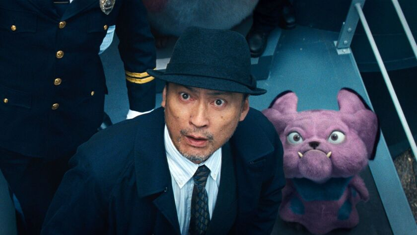 This image released by Warner Bros. Pictures shows Ken Watanabe and the character Snubbull in a scen