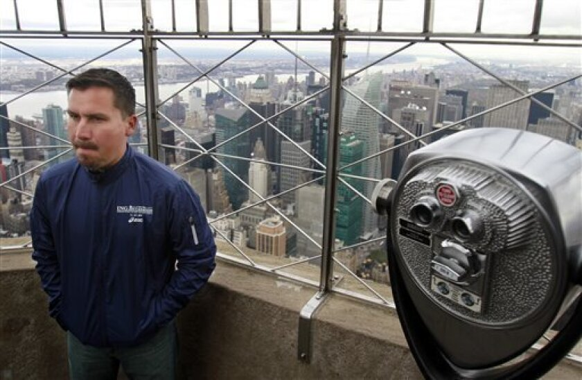 Rescued Chilean miner Edison Pena visits the Empire State Building observation deck on Friday, Nov. 5, 2010, in New York. Pena is aiming to finish the New York City Marathon on Sunday. (AP Photo/Bebeto Matthews)