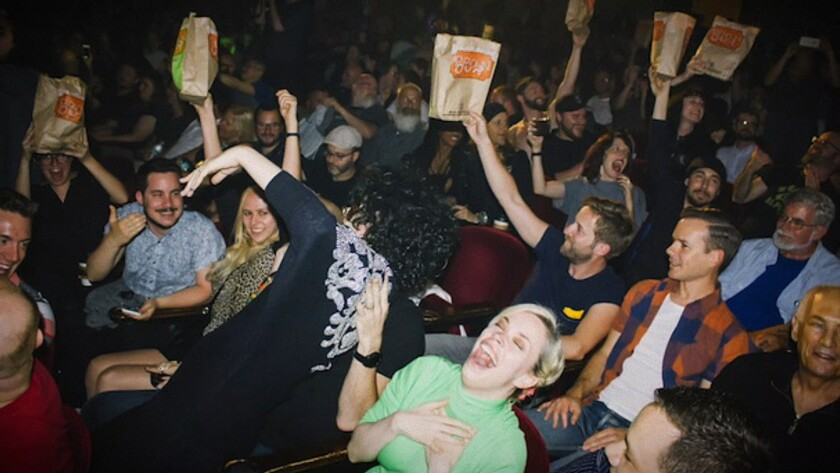 "Audience at ""Showgirls"" in the documentary ""You Don't Nomi."""