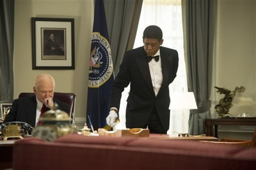 """This film image released by The Weinstein Company shows Robin Williams as Dwight Eisenhower, left, and Forest Whitaker as Cecil Gaines in a scene from """"Lee Daniels' The Butler."""" (AP Photo/The Weinstein Company, Anne Marie Fox)"""