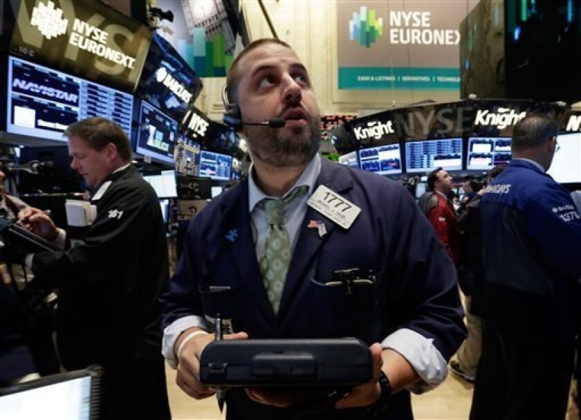 Trader Michael Hagis works on the floor of the New York Stock Exchange.