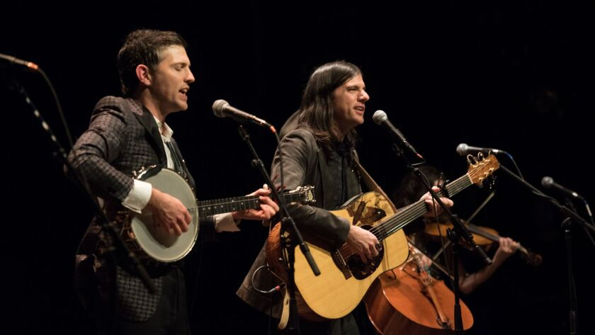 "Scott, left, and Seth Avett of the Avett Brothers onstage at the premiere of ""May It Last: A Portrait of the Avett Brothers"" in New York in January."