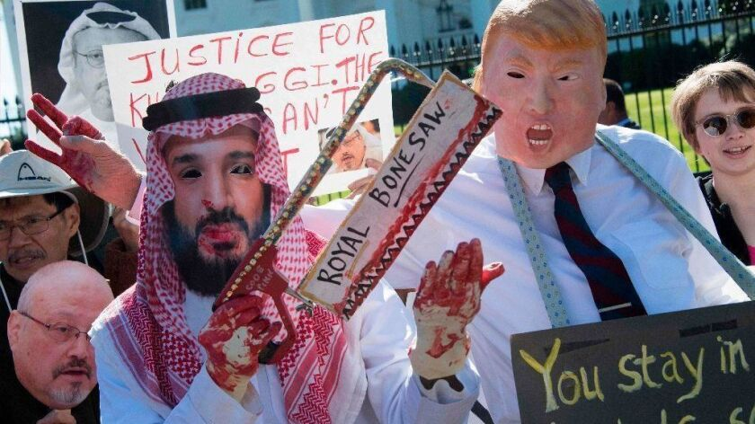 Demonstrators dressed as Saudi Arabia Crown Prince Mohammed bin Salman and President Trump protest outside the White House on Oct. 19.