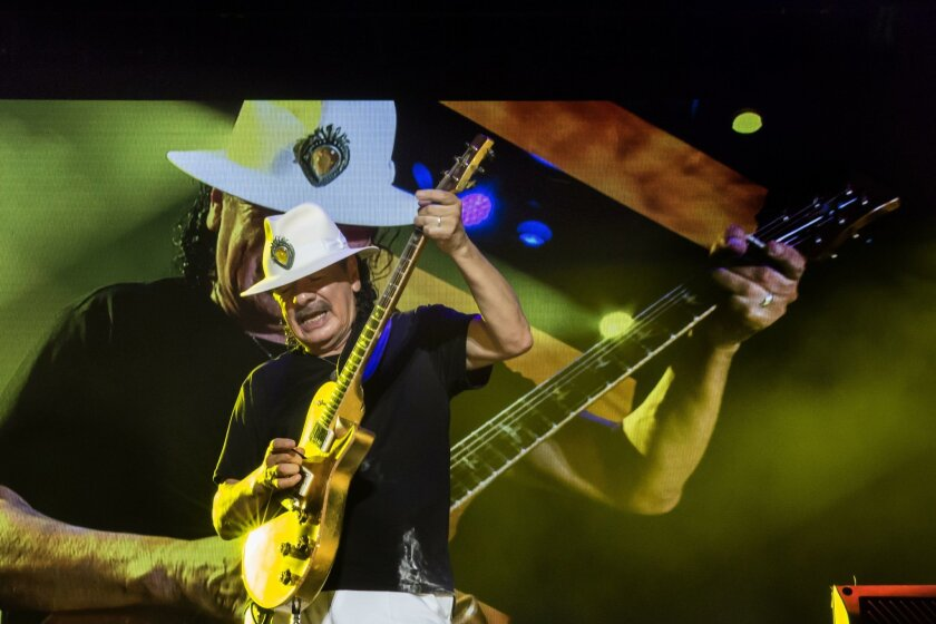 Carlos Santana performs in Tel Aviv, Israel, in July as part of his worldwide concert tour.