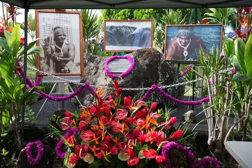 This Dec. 3, 2015 photo provided by Quiksilver shows a shrine for big wave surfer Eddie Aikau at Waimea Bay near Haleiwa, Hawaii, during the official opening ceremony of the Quiksilver In Memory of Eddie Aikau big wave competition. Event organizers say the competition will take place Wednesday, Feb