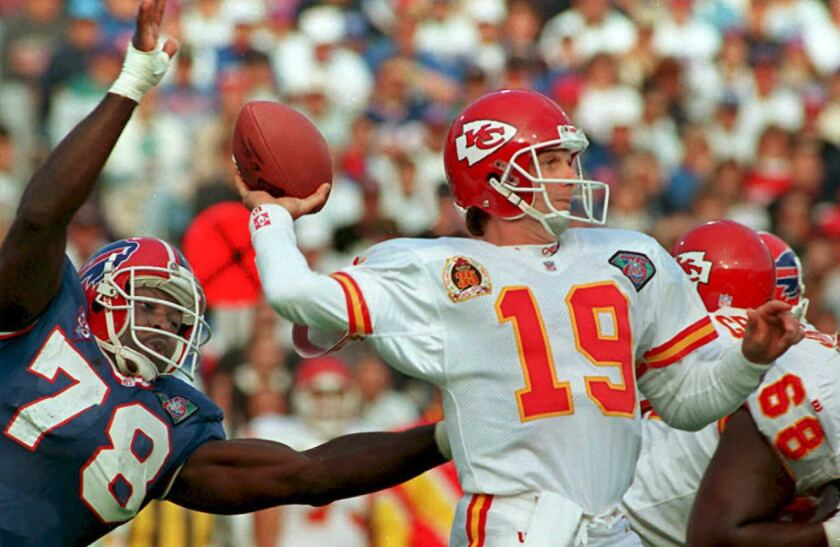 Chiefs quarterback Joe Montana looks to pass under pressure from Bills defensive end Bruce Smith on Oct. 30, 1994