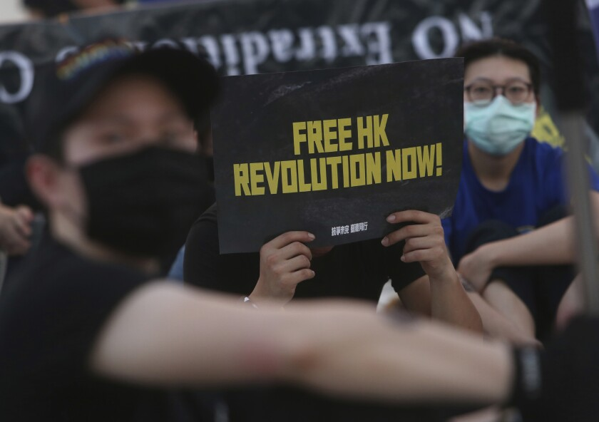 Hong Kong protesters in Taiwan and Taiwanese supporters gathered Saturday to mark the first anniversary of a mass rally.