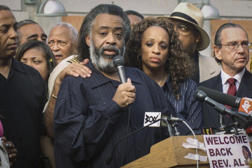 FILE - This Friday Aug. 17, 2001 file photo shows Rev. Al Sharpton, center, with his wife Kathy Jordan, third from left, as he speaks at a press conference following his released from the Metropolitan Detention Center in Brooklyn, N.Y. More than 16 years after separating, Rev. Al Sharpton has filed for divorce from his estranged wife, Kathy Jordan Sharpton. (AP Photo/Ed Bailey, File)