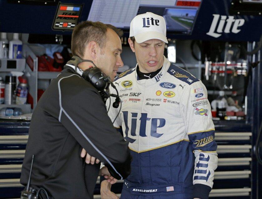 Brad Keselowski, right, talks with his crew chief Paul Wolfe during a practice session for the NASCAR Daytona 500 auto race at Daytona International Speedway, Saturday, Feb. 13, 2016, in Daytona Beach, Fla. (AP Photo/Terry Renna)