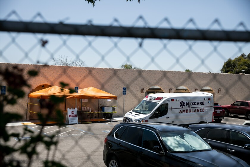 An ambulance is parked outside the Reo Vista Healthcare Center on Thursday.