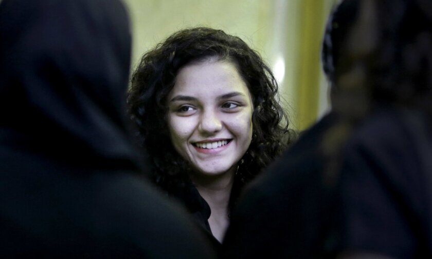 FILE - In this Saturday, Aug. 30, 2014 file photo, Sanaa Seif, the younger daughter of Ahmed Seif, one of Egypt's most prominent civil rights lawyer and campaigner, receives condolences for her father at Omar Makram mosque after being temporarily released form prison, in Cairo, Egypt. When Seif was