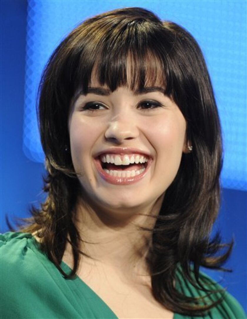 """Demi Lovato, star of the Disney Channel series """"Sonny With a Chance,"""" participates in a panel discussion at the Television Critics Association Winter Press Tour  in Los Angeles, Friday, Jan. 16, 2009. (AP Photo/Chris Pizzello)"""