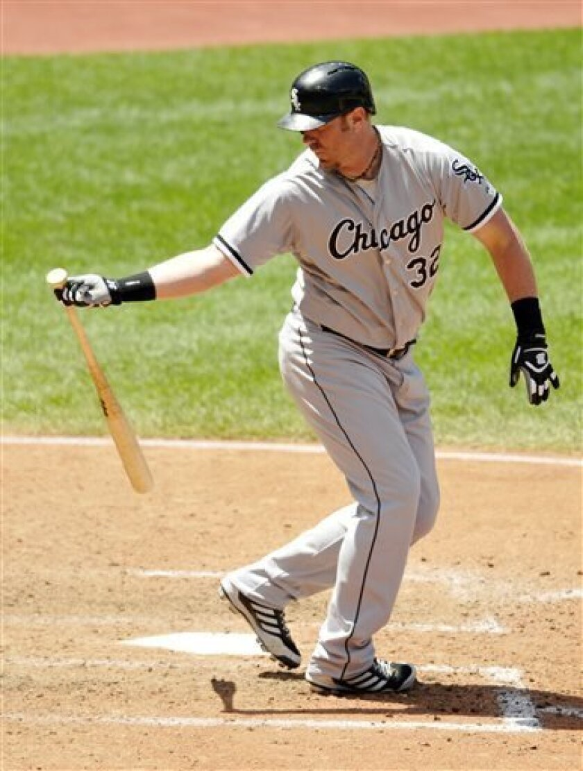 Chicago White Sox designated hitter Adam Dunn strikes out against the Cleveland Indians in the eighth inning of a baseball game, Thursday, Aug. 1, 2013, in Cleveland. (AP Photo/David Richard)