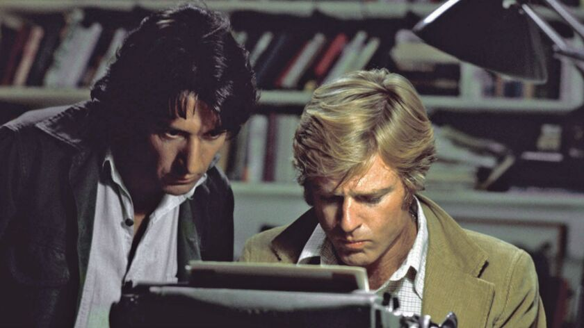 In this file photo provided by Warner Bros., actors Robert Redford, right, and Dustin Hoffman appear