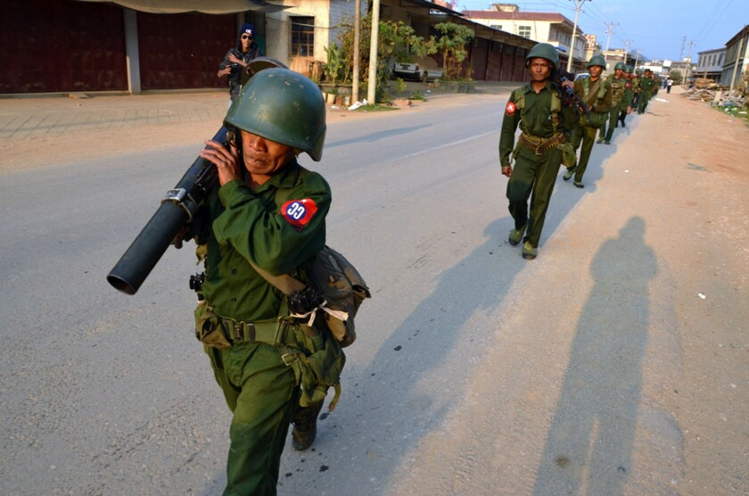 Myanmar soldiers patrol in Kokang on Feb. 17.
