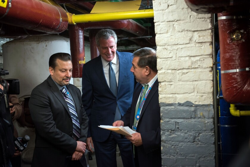 Mayor Bill de Blasio (center) is pictured with NYCHA officials while visiting a heating plant at the agency's Lower East Side Rehab Houses this week.