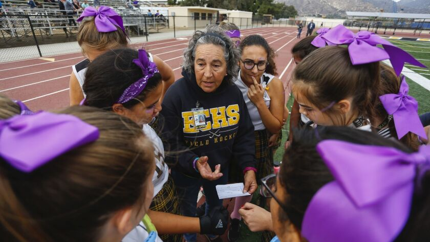 El Capitan High School field hockey coach Sandy Galea-Martinez talks with her varisty team before their game against Santana on Monday, October 22nd, 2018.
