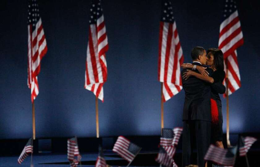 U.S. President-elect Barack Obama kisses his wife, Michelle, after Obama gave his victory speech during an election night gathering in Grant Park on Nov. 4, 2008 in Chicago.