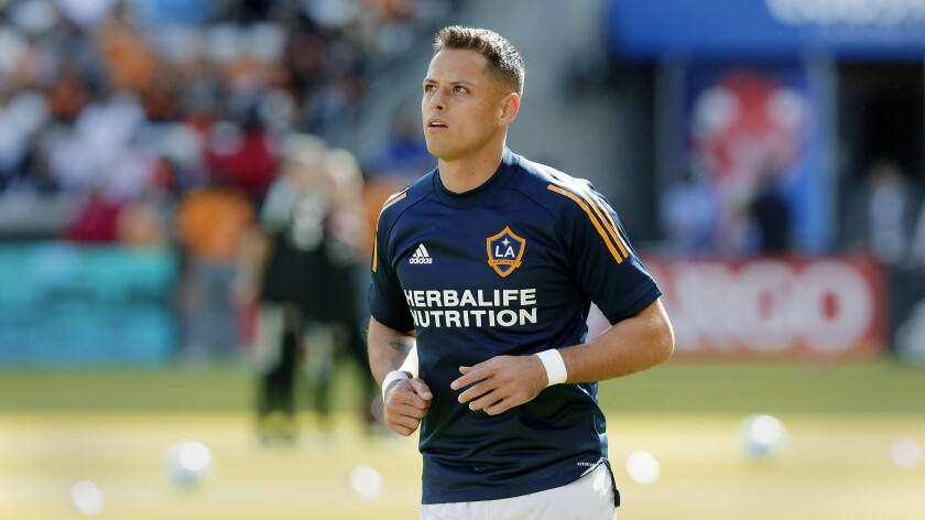 """Galaxy forward Javier """"Chicharito"""" Hernández warms up before a game."""