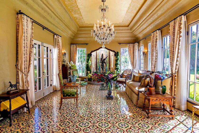 Artisans from around the world were commissioned to build the 1928 Home of the Week, which features Italian tile floors, plaster walls and hand-painted ceilings and beams.