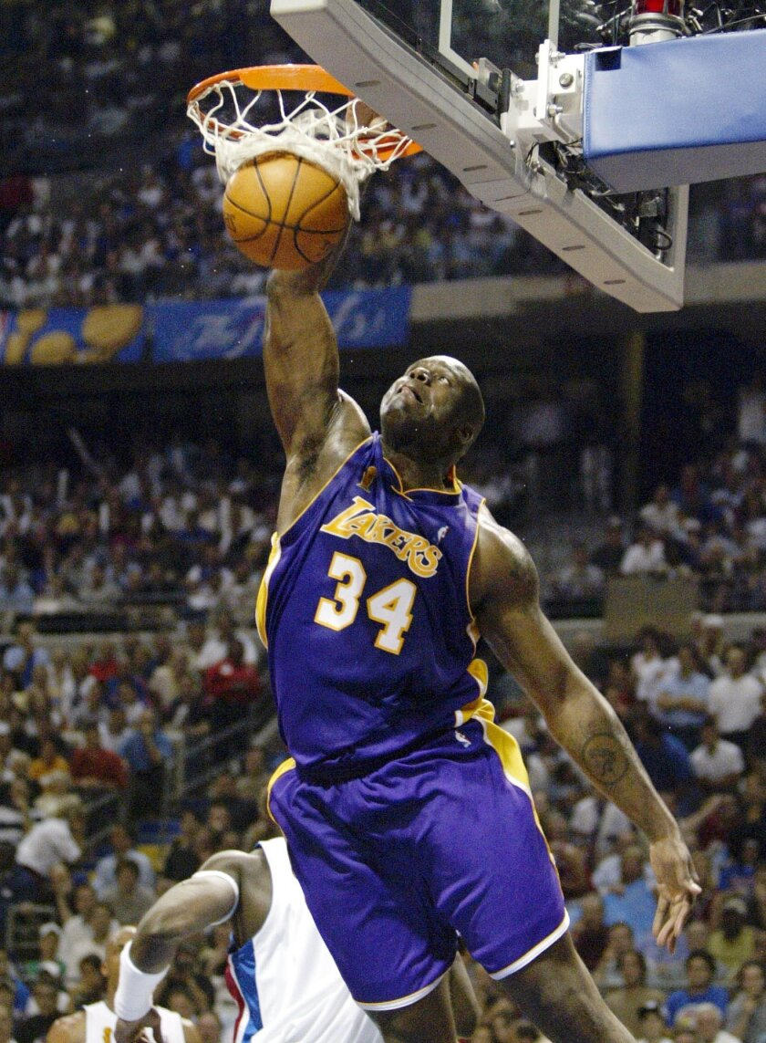 FILE - In this June 15, 2004, file photo, Los Angeles Lakers Shaquille O'Neal (34) dunks the ball against the Detroit Pistons in Game 5 of the NBA Finals in Auburn Hills, Mich. This year's Hall of Fame class includes a star-studded field of potential finalists, including Shaquille O'Neal, Yao Ming