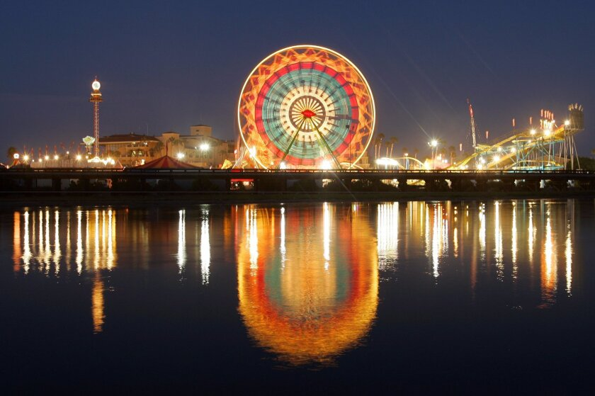 The Ferris wheel does what smokers do in designated areas at the Del Mar fair, and lights up.