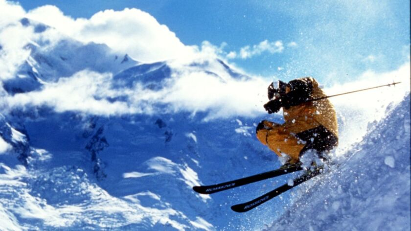 A skier in Chamonix, France, is captured in midair in one of Warren Miller's many films.