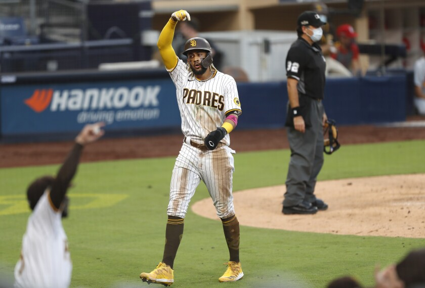 Fernando Tatis Jr. of the San Diego Padres scores on a double by Eric Hosmer in the 5th inning.